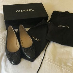 Black Chanel ballet flats with patent leather toe